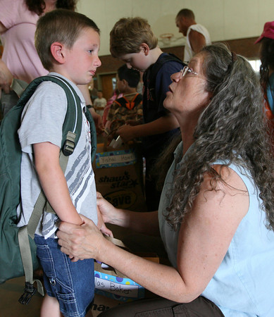 Gloucester: Douglas Baker holds back tears as he says goodbye to his kindergarten teacher, Ms. Allen, on the last day of school at Veterans Memorial Elementary School yesterday. Photo by Kate Glass/Gloucester Daily Times