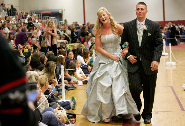 Gloucester: Gloucester senior Brittany Diamond and her date Jake Greeke parade around the Benjamin A. Smith fieldhouse during the Gloucester High School promenade Thursday evening. The students got to show off their formal attire before heading to their prom at Danvers Port Yacht Club. Mary Muckenhoupt/Gloucester Daily Times