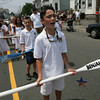 """Gloucester: B.J. Mohan leads the """"Viva San Pietro"""" chant while marching with the oars in the procession of St. Peter yesterday afternoon. Photo by Kate Glass/Gloucester Daily Times"""