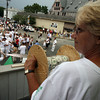 Gloucester: Roseann Dodge holds a spool of money for the statue of Saint Peter during the procession yesterday afternoon. Photo by Kate Glass/Gloucester Daily Times