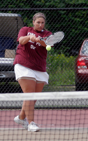 Gloucester: Gloucester's Mary Unis returns a serve as she plays Triton's Sydney White in the Quarter Finals of the MIAA Division 2 North Tennis Tournament at Gloucester High School yesterday afternoon. Photo by Kate Glass/Gloucester Daily Times