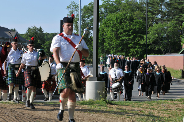 Manchester: The Manchester Essex Class of 2010 was lead to Ed Field Field by bagpipers. Photo by Desi Smith/Gloucester Daily Times