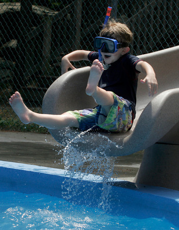 Gloucester: Jack Vieira, 7, smiles as he shoots out of the large waterslide at the YMCA's Camp Spindrift yesterday afternoon. Photo by Kate Glass/Gloucester Daily Times