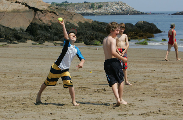 Gloucester: Jameson Kamm pitches during a beach baseball game as the  Rockport Elementary School fifth grade class, soon to be sixth graders, have a beach party at Front Beach Friday afternoon. Pictured to the right of Kamm is Gideon Roell. Mary Muckenhoupt/Gloucester Daily Times