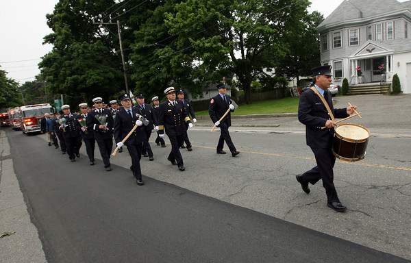 Gloucester: Gloucester Firefighter Jay Frontiero plays a drum cadence as the Gloucester firefighters march up Washington Street toward the Cherry Hill Cemetery to honor those who have passed away during the Firefighters Memorial Service yesterday morning. Frontiero, who a drum passed down from his father, has been the drummer during this service for 30 years and will be retiring next month. Photo by Kate Glass/Gloucester Daily Times