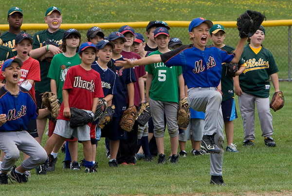Gloucester: Jack Sperry, 10, celebrates after hitting the target while playing Hit the Target during the 5th Annual Gloucester Little League Family Picnic & Skills Day at Boudreau Frield Saturday. The day included a variety of baseball activities including a basball clinic with the Gloucester High School baseball team, homerun derby, and a dunk tank. Mary Muckenhoupt/Gloucester Daily Times