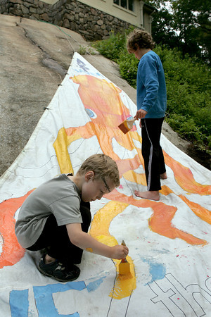 Gloucester: Hunter Gillis, 6, and Lasse Struppe, 9, help to paint a sail for the Cape Ann Art Haven at the Celebration of the Sea, a Cape Ann Family Festival at the Eastern Point Day School Saturday. The event included shopping with local artisans, face painting, tale-telling pirates, giant puppets and more. Mary Muckenhoupt/Gloucester Daily Times