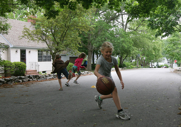 Rockport: Nina McCloy plays basketball on Wednesday afternoon as her friends play tag. Photo by Kate Glass/Gloucester Daily Times