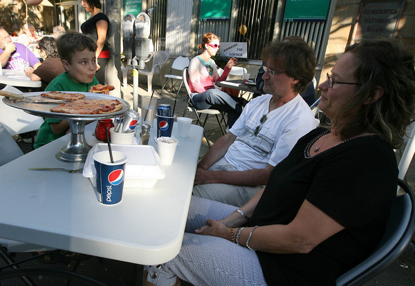 Gloucester: Harald and Anne Pagunetti enjoy dinner with their son, Enzo, at Espresso Restaurant during the Main Street Block Party on Saturday night. Photo by Kate Glass/Gloucester Daily Times<br /> TRC, Gloucester: Harald and Anne Pagunetti enjoy dinner with their son, Enzo, at Espresso Restaurant during the Main Street Block Party on Saturday night. Photo by Kate Glass/Gloucester Daily Times<br /> TRC