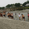 Gloucester: Local athletes sprint up the creek at Good Harbor Beach as they participate in a conditioning clinic run by Mike Lattof yesterday morning. Photo by Kate Glass/Gloucester Daily Times