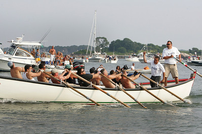 Gloucester: Coxswain Joe Novello and scuttler Tim Oakes cheer as Koas hits Pavillion beach first and are named the men's senior seine boat champs. Mary Muckenhoupt/Gloucester Daily Times