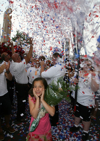 Gloucester: Piera Locontro smiles as confetti flies above her head at the end of the procession of St. Peter yesterday afternoon. Photo by Kate Glass/Gloucester Daily Times