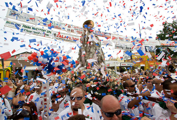 Gloucester: Confetti fall on the crowd and staue carriers in front of St. Peter's Club at the end if Sunday's Fiest procession. Mary Muckenhoupt/Gloucester Daily Times