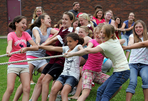 Rockport: Rockport sixth grade girls pull with all their might during a tug of war with the seventh grade girls for Field Day Thursday afternoon.  This was the last event of the day before students were dismissed for summer vacation. Mary Muckenhoupt/Gloucester Daily Times