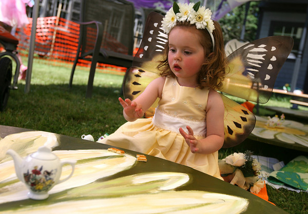 Essex: Riley McKinnon, 2, of Essex has a cookie and some tea during the 7th Annual Fairy Festival at Underwood Photography in Essex on Saturday. A portion of the proceeds from the event will be donated to Cape Ann Habitat for Humanity. Photo by Kate Glass/Gloucester Daily Times