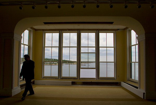Rockport: Tom Burger, chairman of Rockport Music, walks past the windows on the third floor of the Shalin Lui Performance Center Wednesday afternoon.  When completed the third floor with be a function hall giving panoramic views from 40 feet up. Mary Muckenhoupt/Gloucester Daily Times