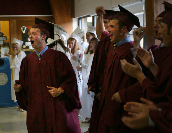 Rockport: Brendan Douglass and Mike Emerson cheer as they get ready to march into the Stephen A. Rowell Gymnasium for Rockport High School's graduation ceremony last night. Photo by Kate Glass/Gloucester Daily Times