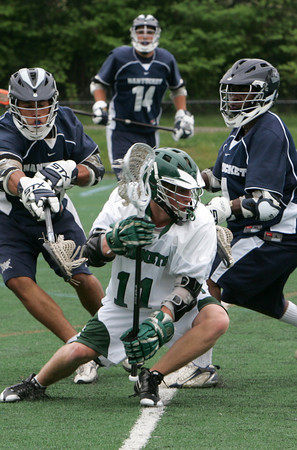 Manchester: Manchester Essex's Colin Lyne cradles the ball handles around   Nantucket's Curren Huyser and Kevin McLean, right, while playing Nantucket in Division 3 East preliminary round at Coach Ed Field Field Wednesday afternoon. Mary Muckenhoupt/Gloucester Daily Times