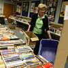 "Gloucester: Betty Nicastro sorts through boxes of books at the Sawyer Free Library yesterday afternoon as they prepare for the ""Friends of the Library Annual Book & Bake Sale."" There will be a special ""friends only"" preview tonight from 4-7 and the sale is open to the public on Saturday from 9-1. Photo by Kate Glass/Gloucester Daily Times"