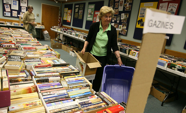 """Gloucester: Betty Nicastro sorts through boxes of books at the Sawyer Free Library yesterday afternoon as they prepare for the """"Friends of the Library Annual Book & Bake Sale."""" There will be a special """"friends only"""" preview tonight from 4-7 and the sale is open to the public on Saturday from 9-1. Photo by Kate Glass/Gloucester Daily Times"""