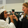 """Manchester: Alessia Guerriero and Manchester Essex girls basketball coach Lauren Dubois pinkie swear before the school's graduation ceremony last night. """"Best friends always,"""" they said after. Photo by Desi Smith/Gloucester Daily Times"""