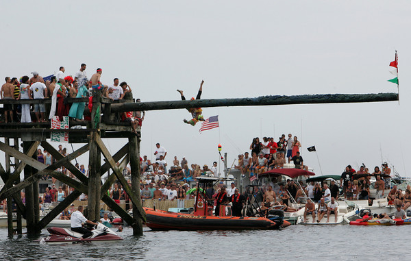 Gloucester: Vincenzo DiMaio proves it is not easy being greasy as he falls off the greasy pole Saturday.  Mary Muckenhoupt/Gloucester Daily Times