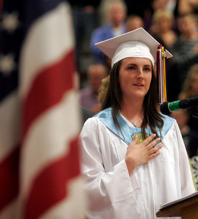 Gloucester: Pamela Tobey leads the Pledge of Allegiance during Gloucester High School's graduation ceremony in the Benjamin A. Smith Fieldhouse yesterday afternoon. Photo by Kate Glass/Gloucester Daily Times