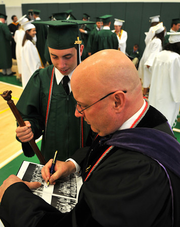 Manchester: Matt Hoyle, a member of the debate team, has his teacher, Mr. William Cooper, sign his year book in the Manchester Essex Regional High School Gym. Photo by Desi Smith/Gloucester Daily Times