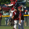 Gloucester: GLoucester's Sal Taormina and Joseph Avila leap in the air as they celebrate the Fishermen's 7-6 win over Dracut in the Quarter Finals of the MIAA North Division 2 Baseball Tournament at Nate Ross Field yesterday. Photo by Kate Glass/Gloucester Daily Times