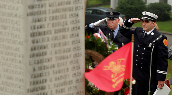 Gloucester: Gloucester Firefighter Mike Chipperini and Captain Phil Harvey salute as they honor those who have passed away during the Firefighters Memorial Service held Sunday morning at Cherry Hill Cemetery. Photo by Kate Glass/Gloucester Daily Times