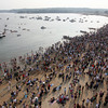 Gloucester: A large crowd gathers at Pavilion Beach yesterday evening to watch the greasy pole contest and seine boat races. Photo by Kate Glass/Gloucester Daily Times
