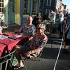 Gloucester: Lucy Gatchell, Tom Bernie and Becky Bernie enjoy a glass of wine outside the Dog Bar during the block party on Saturday night. Photo by Kate Glass/Gloucester Daily Times