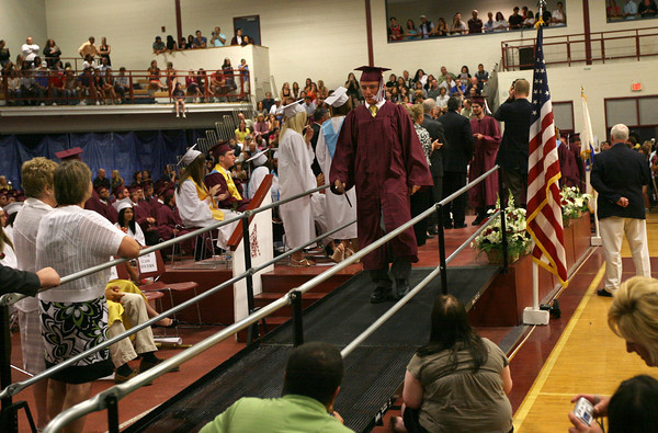 Gloucester: Conor Ressel receives his diploma during Gloucester High School's graduation ceremony in the Benjamin A. Smith Fieldhouse yesterday afternoon. Photo by Kate Glass/Gloucester Daily Times