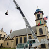 Gloucester: A bell gets lifted into one of the towers at Our Lady of Good Voyage Church Wednesday morning. The bells were taken away for repairs last October and all 31 are being put back in place so they can once again ring.  The bells, which have been at the church for almost 90 years and were the first tuned carillon in the United States. Mary Muckenhoupt/Gloucester Daily Times