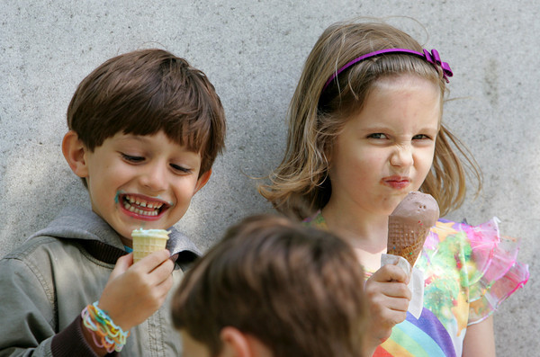 Manchester: Addison Loughery, 6, makes a face at her brother Trenton, 8, font, while eating ice cream with her friend Julian Friends, 6, at Masconomo Park Friday afternoon. Mary Muckenhoupt/Gloucester Daily Times