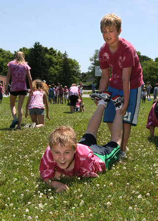 Essex: Fritz Spofford laughs as he falls while competing in the wheelbarrow race with classmate Sam Prudden during Essex Elementary School's Field Day on their last day of school yesterday. Photo by Kate Glass/Gloucester Daily Times