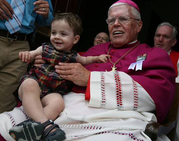 Gloucester: Connor Douglas Mahoney, 1, smiles as he is blessed by Bishop Frank Irwin at St. Ann Church during the procession of St. Peter yesterday afternoon. Photo by Kate Glass/Gloucester Daily Times