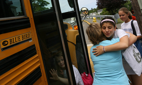 Gloucester: Michelle Puccio hugs her 5th grade teacher, Annmarie Rad, before getting on the bus at Veterans Memorial Elementary School on the last day of school yesterday. Photo by Kate Glass/Gloucester Daily Times