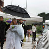 Gloucester: Gloucester senior Chelsea Place stays dry as her limo driver holds and umrella for her and her date C.J. Favazza after leaving the Gloucester promenade Thursday evening. The Gloucester prom was held at the Danvers Port Yaught Club. Mary Muckenhoupt/Gloucester Daily Times
