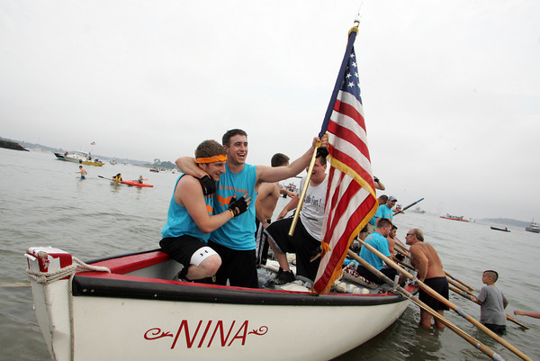 Gloucester: Relentless teammates Paul Russo and Jeremy Fanning celebrate after their team won the junior boy seine boat race Sunday at Pavilion Beach. Mary Muckenhoupt/Gloucester Daily Times