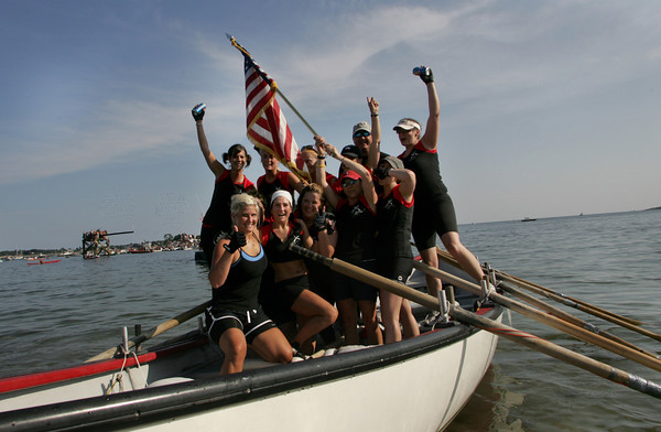 Gloucester: Oar'dacious, captained by Joe Balbo, celebrates after winning the woman's seine boat championship Friday night. Mary Muckenhoupt/Gloucester Daily Times