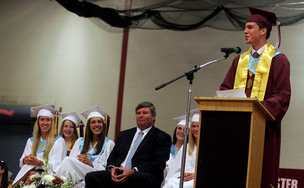 Gloucester: Christopher Peritore delivers the valedictorian address during Gloucester High School's graduation ceremony in the Benjamin A. Smith Fieldhouse yesterday afternoon. Watching on left are: Allison Phillips, Nancy Frye, Sabrina Parisi, Principal William Goodwin, Brianna Aloisio, and Casey McCarthy. Photo by Kate Glass/Gloucester Daily Times