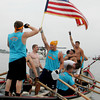 Gloucester: Relentless teammates celebrate, including Derek Pratt waving the American Flag, after the team won junior boy seine boat race Sunday at Pavilion Beach. Mary Muckenhoupt/Gloucester Daily Times
