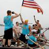 Gloucester: Relentless teammates celebrate, including Derek Pratt waving the American Flag, after the team won junior boy seine boat race Sunday at Pavilion Beach. Mary Muckenhoupt/Gloucester Daily Times