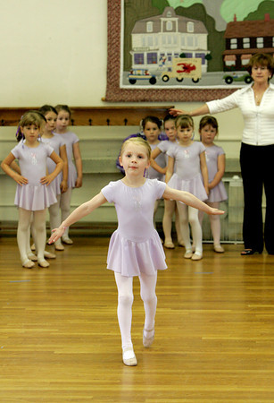 Manchester: Gracie Susko, 6, of Manchester dances across the floor during her dance recital Saturday afternoon.  Robin Adair Studio of Dance held it's beginner ballet recital at the First Parish Chapel Saturday afternoon. Mary Muckenhoupt/Gloucester Daily Times