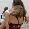 Gloucester: Gabrielle Oakes, 4, who's nickname is Goober, takes a nap on her mother's shoulder amidst all the noise at Pavilion beach Sunday evening. Gabrielle's father, Tim, was out scuttling a seine boat while she napped. Mary Muckenhoupt/Gloucester Daily Times
