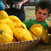 Gloucester: Charlie Doud, 3, of Gloucester, checks out a variety of squash at Farmer Dave's stand at the Cape Ann Farmer's Market on Rogers Street yesterday afternoon. The market runs every Thursday through the summer. Photo by Kate Glass/Gloucester Daily Times