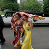 Gloucester: Sarah Kipp and Selena Capone, right, protect their ahir from the rain as they arrive at Gloucester High School for the promenade held at Benjamin A. Smith Fieldhouse Thursday evening. Mary Muckenhoupt/Gloucester Daily Times