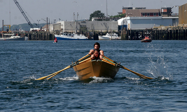 Gloucester: Len Robertson and Christina Carpenter head toward the flag during the International Dory Boat Races at the Jodrey State Fish Pier on Saturday. The two beat Canada's team of Nicole Jones and Rob Hulburt. Photo by Kate Glass/Gloucester Daily Times