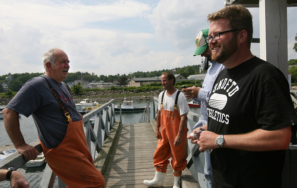 Manchester: Stan Koch and Luke Richards get ready to take Kyle Petty and Rutledge Wood out lobstering yesterday afternoon as they shoot an episode of the Ponytail Express, a short weekly feature about the area around the TNT Series race tracks. NASCAR will be in Loudon, NH this weekend. Photo by Kate Glass/Gloucester Daily Times